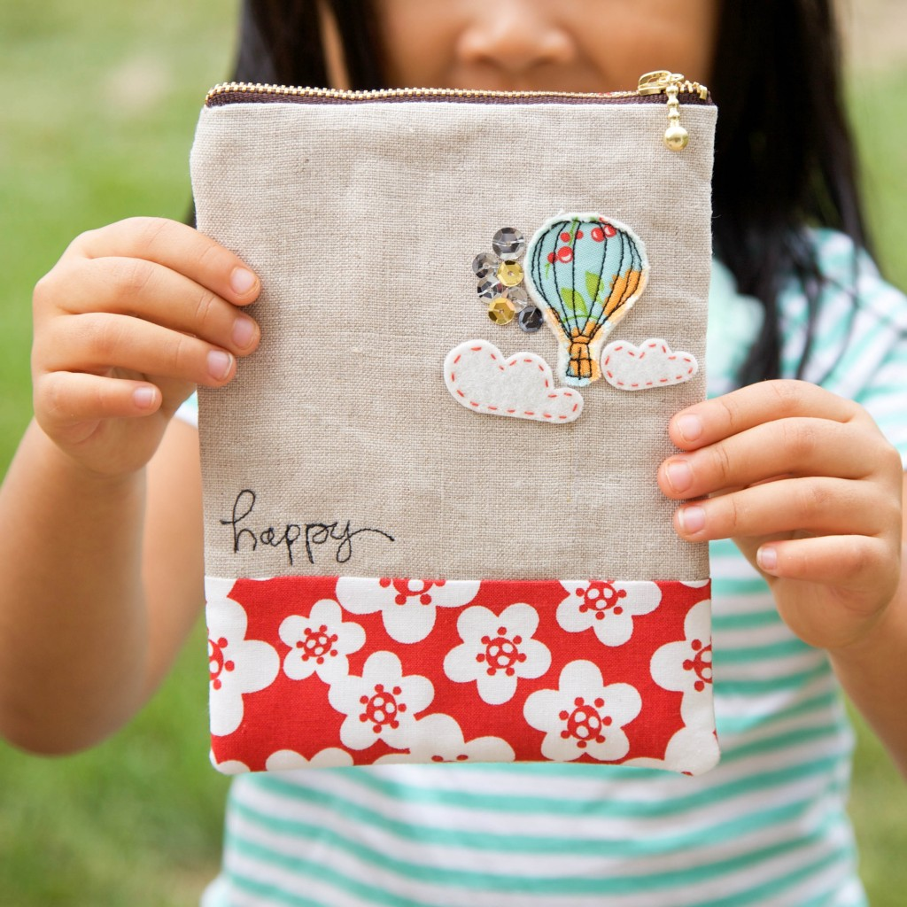 applique hot air balloon and clouds on linen pouch